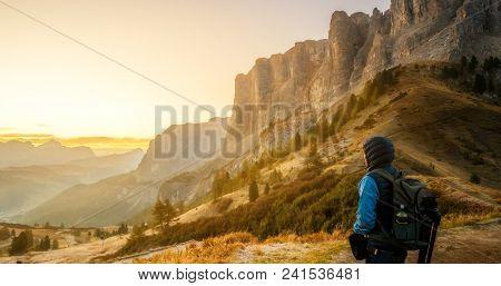 Traveler Hiking Breathtaking Landscape Of Dolomite