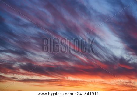 Dramatic Sunset Sky With Clouds. Bright Blue And Orange Sky