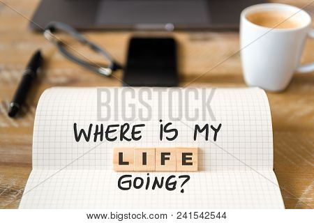Closeup On Notebook Over Table Background, Focus On Wooden Blocks With Letters Making Where Is My Li