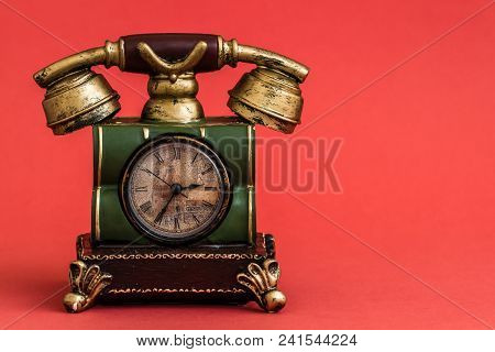 Creative Alarm Clock With Vintage Telephone  Style On Red Background