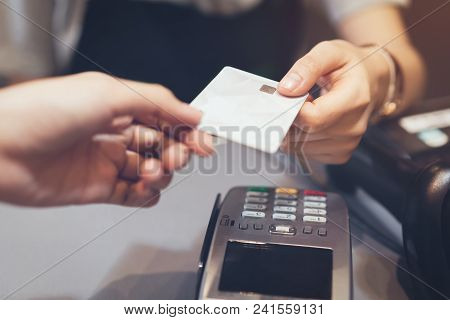 Concept Of Technology In Buying Without Using Cash. Close Up Of Hand Use Credit Card Swiping Machine