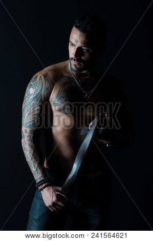 Man With Tattoo Design On Skin. Bearded Man With Muscular Torso. Fashion Model With Leather Belt In