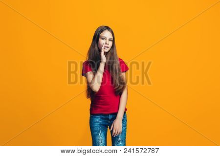 Secret, Gossip Concept. Young Teen Girl Whispering A Secret Behind Her Hand Isolated On Trendy Orang