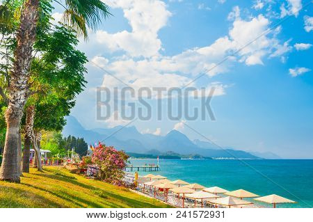 Beautiful Beach With Green Trees In Kemer, Turkey. Summer Landscape, Travel And Vacation