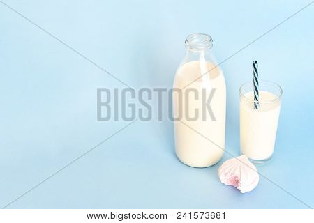 Milk In A Clear Glass Bottle And In A Glass Glass Glass Cup With A Tube And Pink Bitten Marshmallow