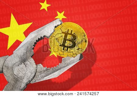 Bitcoin (btc) Coin In A Vice Under Pressure On China Flag Background. Prohibition Of Bitcoin Cryptoc