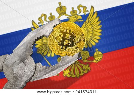 Bitcoin (btc) Coin In A Vice Under Pressure On Russia Flag Background.  Prohibition Of Bitcoin Crypt