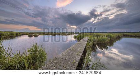Wooden Footbridge Over River As A Concept For Challenge In Nature Reserve De Onlanden Near Groningen