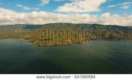 Fish Farm With Floating Cages In Lake Taal. Aerial View: Fish Farming With Cages For Whitebait On Th