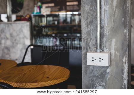 Power Socket On Stone Pillar In Cafe , Service Device For Customer In Coffee Shop