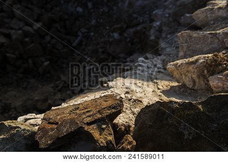 Grunge stone background. Rocky surface. Brown stone background.  Stone. Quarry. Brown stone. Stone texture. Stone style. Grunge stone background. Nature grunge background. Limestone.