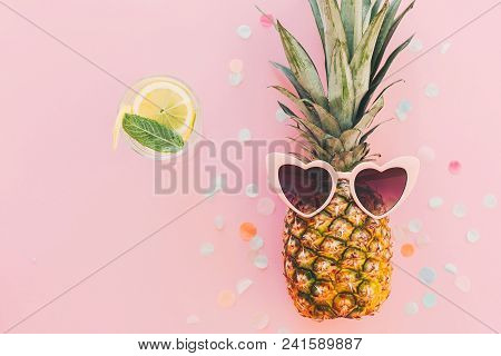 Summer Vacation And Party Concept. Stylish Pineapple In Pink Sunglasses And Cocktail Drink On Trendy