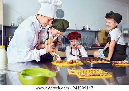 Children Learn To Cook In The Classroom In The Kitchen.