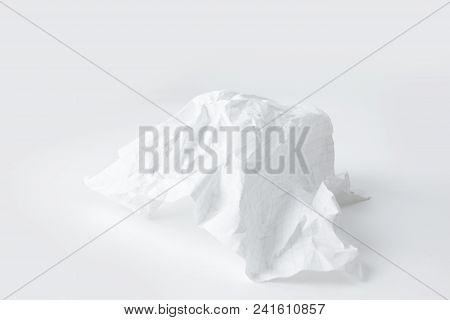 Crumpled School Notebook Sheet On White Background.photo With Copy Space.