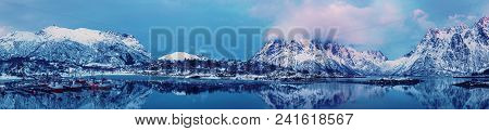 Landscape With Beautiful Winter Lake And Snowy Mountains At Lofoten Islands In Northern Norway. Pano