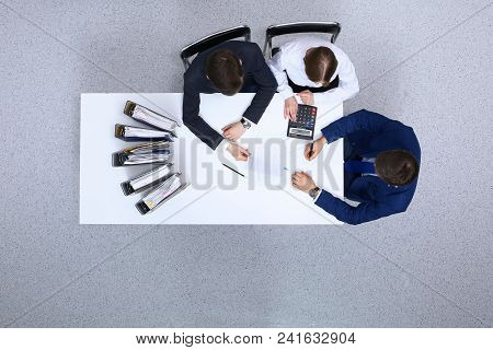 Business People At Meeting, View From Above. Bookkeeper Or Financial Inspector  Making Report, Calcu