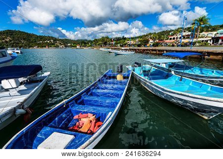 Beautiful View Of Several Fishing Boats On Water In Samana, Dominican Republic