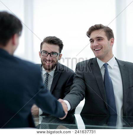 close up.businessman welcomes new business partner