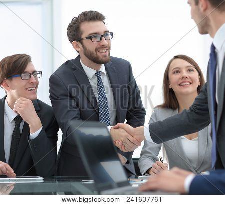 close up.business handshake at the Desk