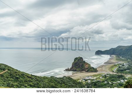 Aerial View Of Seashore And Rocky Cliffs On Cloudy Day, Piha Beach, New Zealand