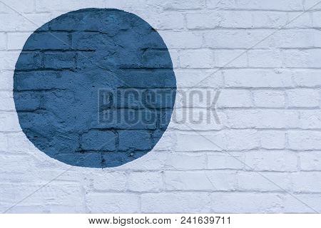 Drawn Painted Blue Circle On A Light Brick Wall Bricks Surface Of Wall, As Graffiti. Graphic Grunge