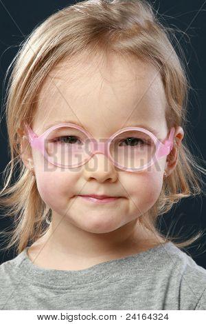 Cute Little Girl Portrait In Pink Glasses