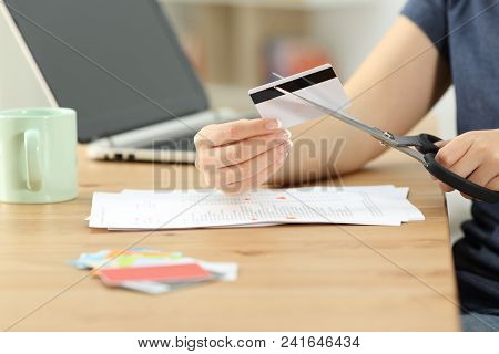 Close Up Of A Woman Hands Destroying Old Credit Cards