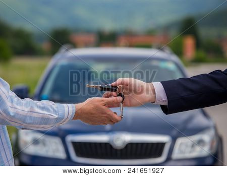 Selling A Car, The Seller Gives The Car Keys To The Buyer, Buying A Car, Buying A New Car With A Smi