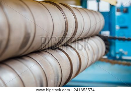 Profiling Rolls Of Sheet Forming Machine Close Up. Selective Focus.