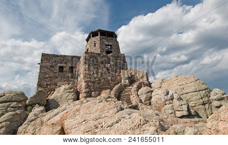 Black Elk Peak [formerly Known As Harney Peak] Fire Lookout Tower Under Cumulus Cloudscape In Custer