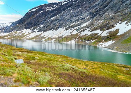 Tourism Holidays And Travel. Lake In Mountains, Norway Scandinavia.