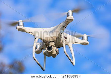 Wallisellen, Switzerland - September 23, 2017: A Dji Phantom 4 Pro Drone Flying, Blue Sky In The Bac