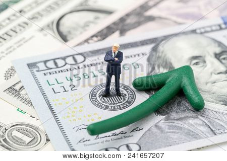 Fed Consider Interest Rate Hike, World Economics And Inflation Control, Miniature Businessman Leader