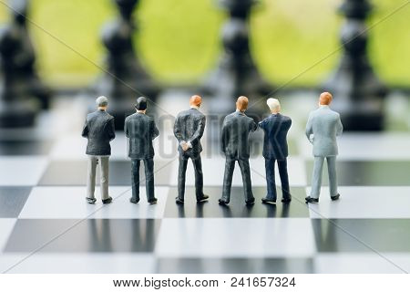 Teamwork In Business Strategy Concept, Group Of Miniature People Businessmen Collaborate Help And Wo