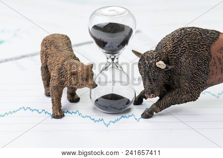 Time Counting Down To Choose Between Investment Bear And Bull Stock Market Concept, Hourglass Or San