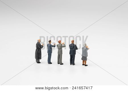 Back View Of Miniature People Happy Team Member, Colleague Or Audiences Clapping Appreciating After