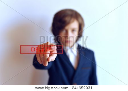 The Young Man Presses The Button To Remove The Outstretched Hand. Teen With The Button Removed. Scho