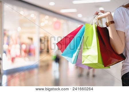 Closeup Of Woman Holding Shopping Colorful Of Shopping Bags At Shopping Mall With Copy Space - Shopp