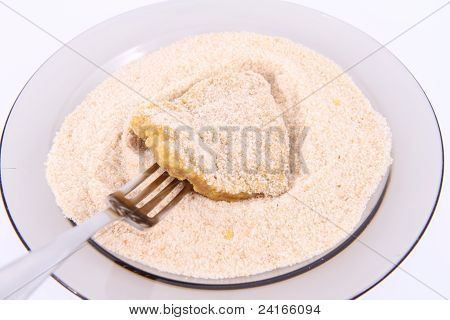 Soy Meat being prepared in breadcrumbs on a plate poster