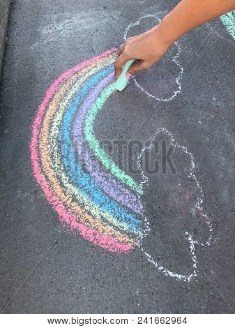 Colorful Hand Drawn Rainbow Chalk Art On Concrete Floor. Outdoor Family Activities, Children Learnin