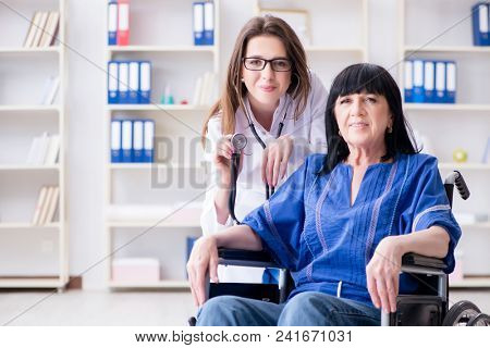 Senior woman visiting doctor for regular check-up