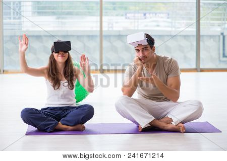 Man and woman with VR glasses meditating