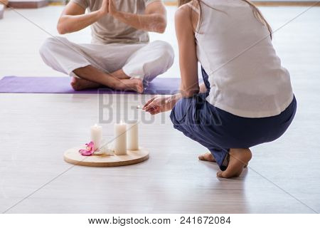 Personal coach helping during yoga session