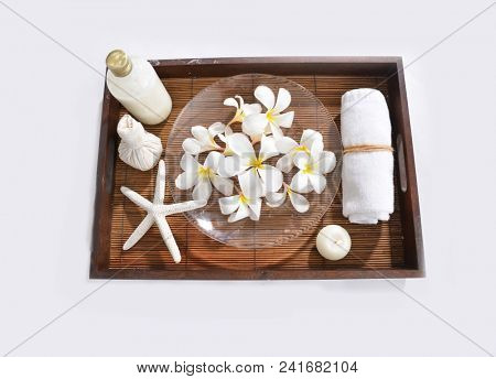 Set of soap. frangipani in wooden bowl with starfish, candle, herbal, ball,, towel in wooden basket