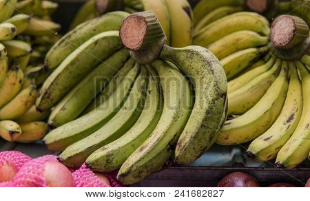Bundles Of Ripe Bananas For Sale In Asian Markets. Tropical Fruits