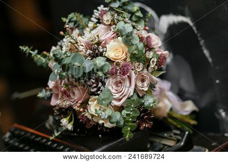 Wedding Bride Bouquet Of Fresh Floral. White Ranunculus Flowers In Womans Hand