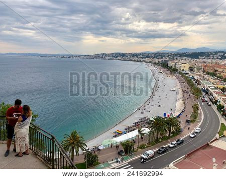 NICE, FRANCE - MAY 21, 2018: The view from the Parc du Château over the rooftops, coastline and mountains of Nice, South of France.
