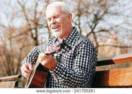 Music Art. Creative Mature Man Singing And Enjoying Guitar Play