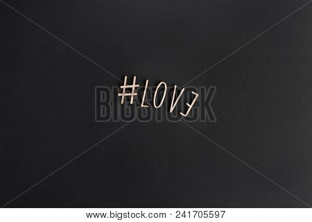 Mockup Of Love Message With Wooden Letters On Sheet Black Paper. Business Mock-up Background For Mes