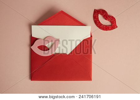 Mockup Red Envelope And White Blank Sheet On Empty Pink Color Desk. Business Empty Mock-up Backgroun